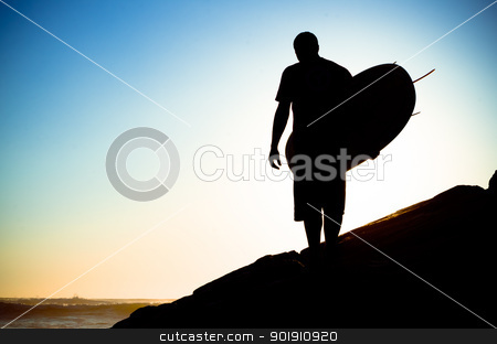 Surfer watching the waves stock photo, A surfer watching the waves at sunset in Portugal. by Homydesign