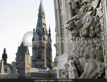 Lion Gargoyle stock photo, A gargoyle lion welcomes you to the canadian Parliament buildings entrance in Ottawa, Canada. by Michel Loiselle