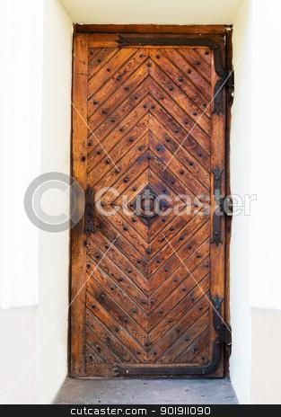 Old wooden door stock photo, Old wooden door with rusty hinges and handle by Iryna Rasko
