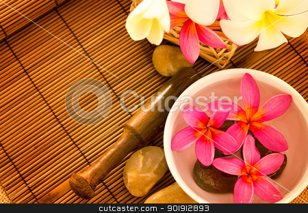 Tropical spa setting stock photo, Tropical spa with Frangipani flowers on water. Low lighting, suitable for spa related theme. by szefei