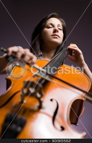 Immersed in classical art. stock photo, Portrait of beautiful young cellist immersed passionate in her music. by exvivo