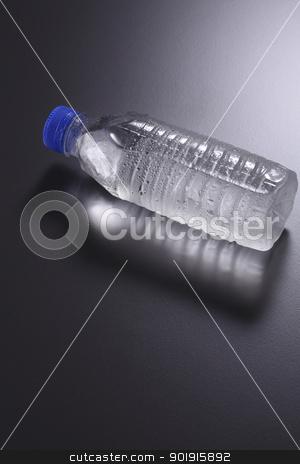 water bottle stock photo, mineral water bottle on the dark background by eskaylim