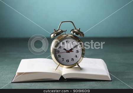 alarm clock on open book stock photo, Close up of books and alarm clock by eskaylim