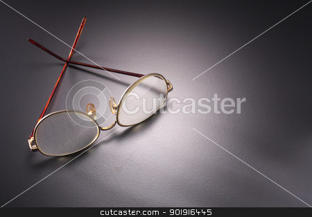 spectacles stock photo, pld glasses on the dark blackground by eskaylim