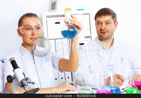 Team of scientists working in laboratory stock photo, Team of scientists working with liquids in laboratory by Sergey Nivens