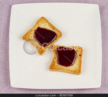 Toasts with jam stock photo, Two little toasts with rapsberry jam over white plate by Fabio Alcini