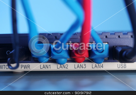 router stock photo, close up of the Ethernet Cables Plugged into Router by eskaylim