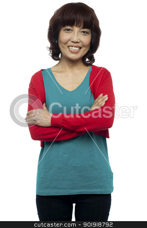 Beautiful asian woman posing with her arms crossed stock photo, Beautiful asian woman posing with her arms crossed isolated over white by Ishay Botbol