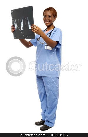 Young medical expert reviewing x-ray report stock photo, Young medical expert reviewing x-ray report isolated over white background by Ishay Botbol