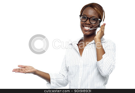 Customer service representative attending calls stock photo, Customer service representative attending calls. Making gestures with hand while explaining it to client by Ishay Botbol
