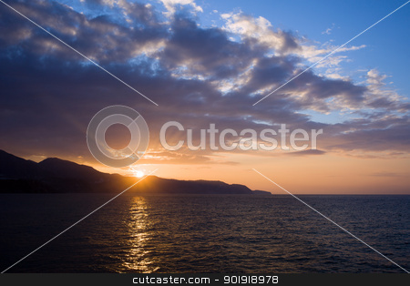 Sunset at Costa del Sol in Spain stock photo, Tranquil sunset on Costa del Sol at the Mediterranean Sea in Spain, Andalucia region, Malaga province. by Rognar