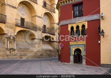 Plaza del Triunfo in Cordoba stock photo, View from the Plaza del Triunfo on the Mezquita Cathedral historic facade and Mudejar style building in Old Town of Cordoba, Spain. by Rognar