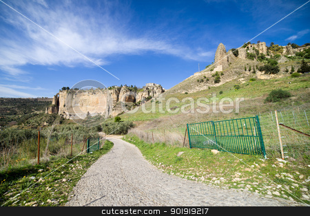 Andalucia Countryside in Spain stock photo, Rural road through a scenic Andalusian hilly landscape in southern Spain, Malaga province. by Rognar