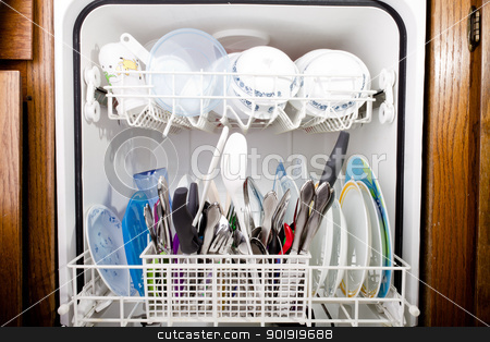 View of the open dishwasher stock photo, Dishwasher set set in the kitchen with wood cupboards to the side. by txking