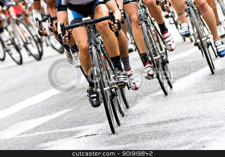 Our race to the finish stock photo, Bike riders trying to race against each other to get to the finish line first on a wet road by txking