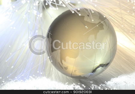 connect to the world stock photo, glass globe with the fiber optic by eskaylim