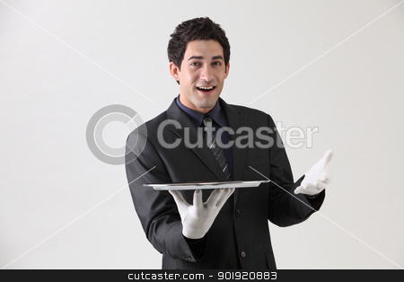 showing empty tray stock photo, Butler holding an empty silver tray by eskaylim