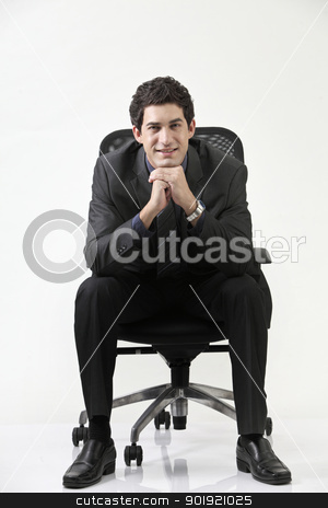 hand on chin stock photo, Business man sitting on office chair by eskaylim