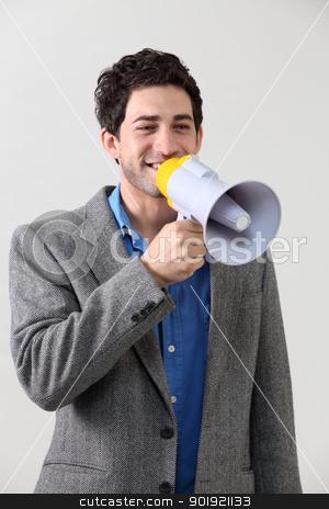 voice out stock photo, Businessman shouting through megaphone by eskaylim
