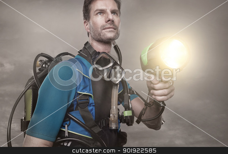 Diver stock photo, Diver in the night with lamp by Picturehunter