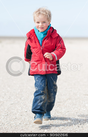 At the beach stock photo, Little boy running at the beach by Picturehunter