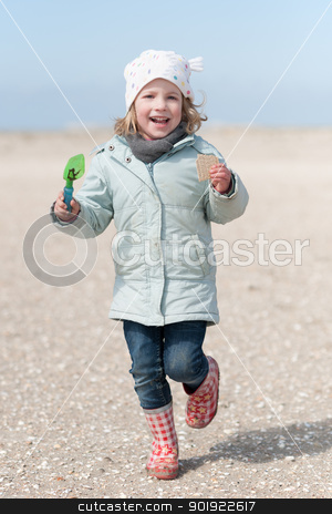 At the beach stock photo, Little girl running at the beach by Picturehunter