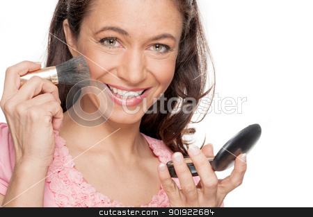 Make up stock photo, Full isolated woman doing some make up by Picturehunter