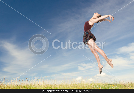 Jumping young woman stock photo, Jumping young woman in front of blue sky by Picturehunter