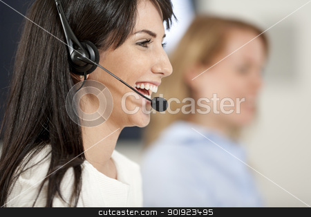 Women in a busy call centre stock photo, Two colleagues working in a busy call centre office. by Gareth Lewis