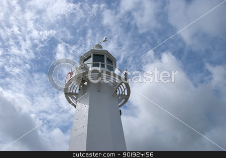 White Lighthouse stock photo, A Lighthouse against a blue cloudy sky by d40xboy