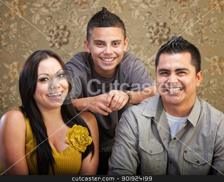Latino Family Laughing Together stock photo, Laughing Latino family with son, mother and father by Scott Griessel