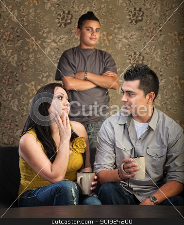 Family With Stubborn Son stock photo, Serious Native American mother and father with stubborn son by Scott Griessel