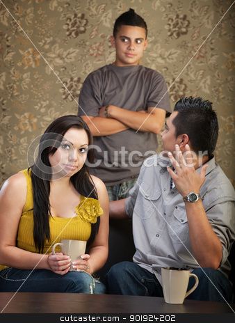 Disprespectful Teen with Parents stock photo, Frustrated father and mother with disrespectful son by Scott Griessel