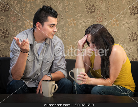 Depressed Woman with Friend stock photo, Depressed young Hispanic woman in conversation with man by Scott Griessel