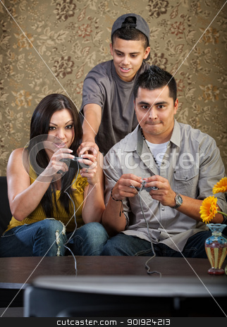 Family Learning To Play Video Games stock photo, Teenager shows parents how to use video game controllers by Scott Griessel