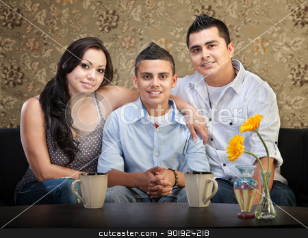 Hispanic Family of Three stock photo, Smiling young Latino family of three sitting together by Scott Griessel