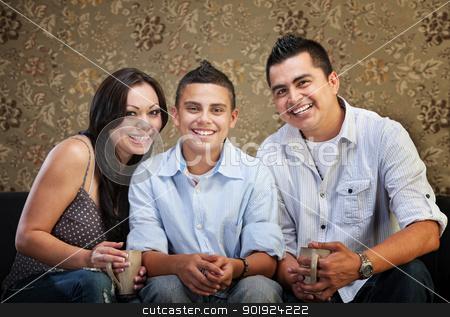 Joyful Hispanic Family stock photo, Joyful Native American family sitting together indoors by Scott Griessel