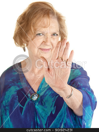 Senior Woman Refusing stock photo, Senior European woman in blue with hand up by Scott Griessel