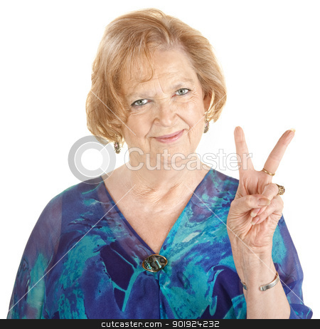 Woman Making Peace Sign stock photo, Cute elderly woman in blue with peace hand gesture by Scott Griessel