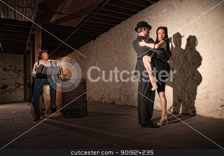 Tango Dancers With Bandonion Player stock photo, Mature tango dancers under spotlight with bandoneon player by Scott Griessel