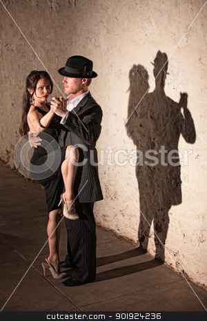 Tango Dancer with Leg On Partner stock photo, Beautiful female tango dancer with leg up next to partner by Scott Griessel
