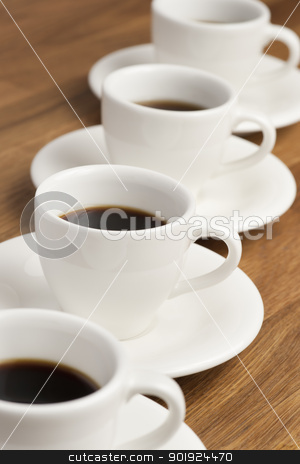 Coffee cups. stock photo, Row of white coffee cups on the table. by Piotr Skubisz