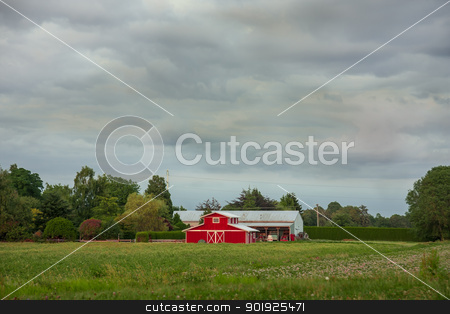 Red Barn stock photo, A rural landscape with farm buildings in the midst of a farmer's field by michael_fox