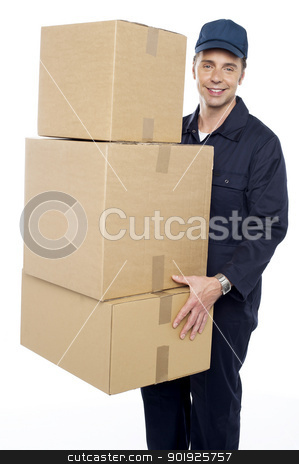 Working man delivering stack of cardboard boxes stock photo, Working man delivering stack of cardboard boxes. Courier delivery by Ishay Botbol