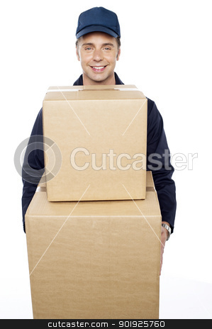 Young man carrying huge cardboard boxes stock photo, Young man carrying huge cardboard boxes. Delivered at your doorstep by Ishay Botbol