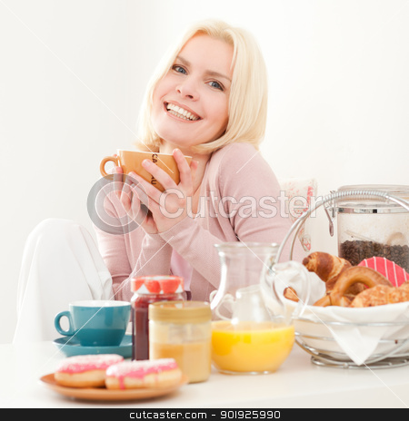 Breakfast stock photo, Young and beautiful woman having breakfast in the morning  by Picturehunter