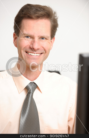 Businessman stock photo, Middle aged and successful businessman in his office by Picturehunter