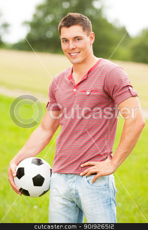 Man with football stock photo, Young man with ball in the park by Picturehunter