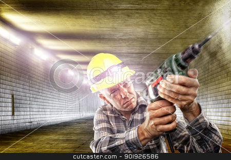 At work stock photo, Construction worker with drilling machine in tunnel by Picturehunter