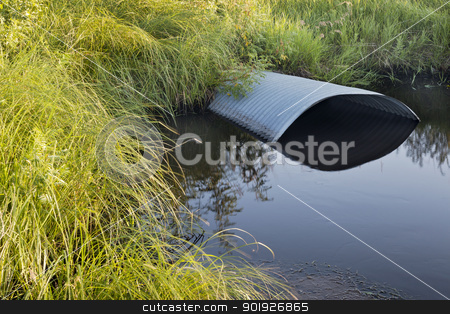 irrigation ditch with culvert stock photo, green meadow and irrigation ditch with culvert by Marek Uliasz